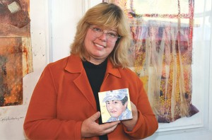 Caryl-Christian-Levy with portrait of Specialist Jane Stewart from Glendale, CA