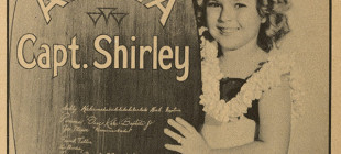 SHIRLEY_TEMPLE_WITH_SURFBOARD