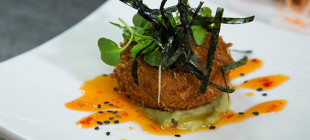 Blue crab cake with avocado butter and sweet chili vinaigrette.