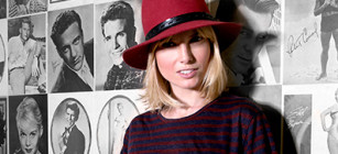 Eugenia Kuzmina against a backdrop of classic Hollywood favorites.