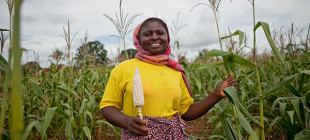 A maize farmer in Tanzania whose crop yields have increased through the use of better seeds thanks to the Agricultural Development programs through the Gates Foundation.