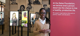 Guide Davida Ingram welcomes guests to the Gates Foundation Visitor Center.