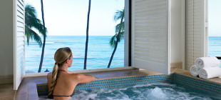 Enjoy invigorating whirlpools with a view of the calming sea.