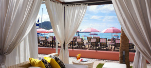 Relax in a private beachfront cabana