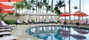 Soak up the sun poolside at The Royal Hawaiian