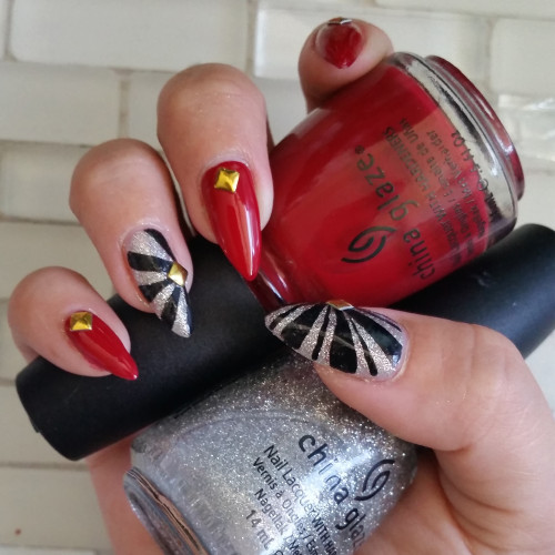 red, glitter and black swirl lines with china glaze